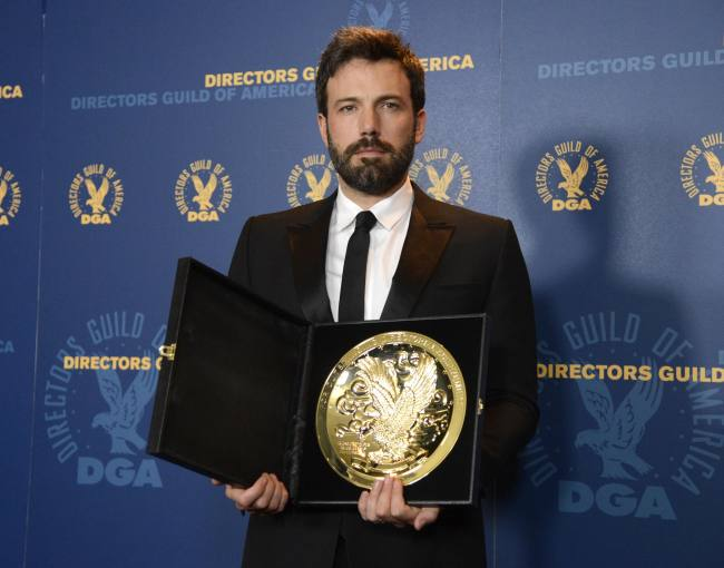Ben Affleck poses for photographers with the Feature Film Award at the 65th annual Directors Guild of America Awards in Los Angeles