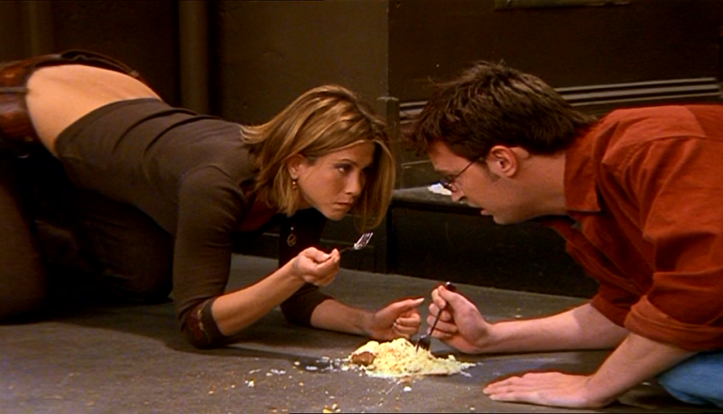Friends Chandler and Rachel eating cheese cake